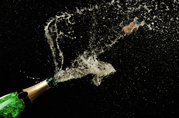 Popping champagne generates a tiny supersonic shockwave